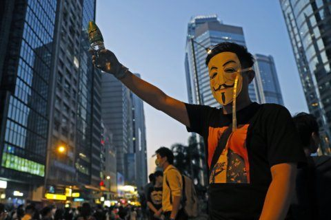 AP Photos: Hong Kong bans protesters from wearing masks