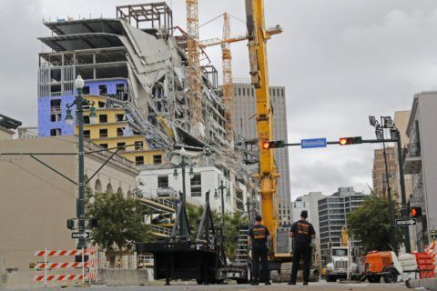 Controlled blasts to bring down cranes at collapse site