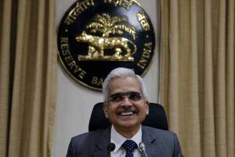 India's central bank cuts interest rate, downgrades outlook