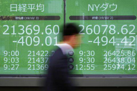 Global stocks mixed amid economy worries