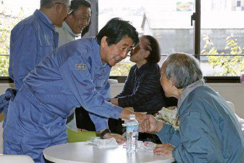 Japan PM visits storm-hit areas; royal parade may be delayed