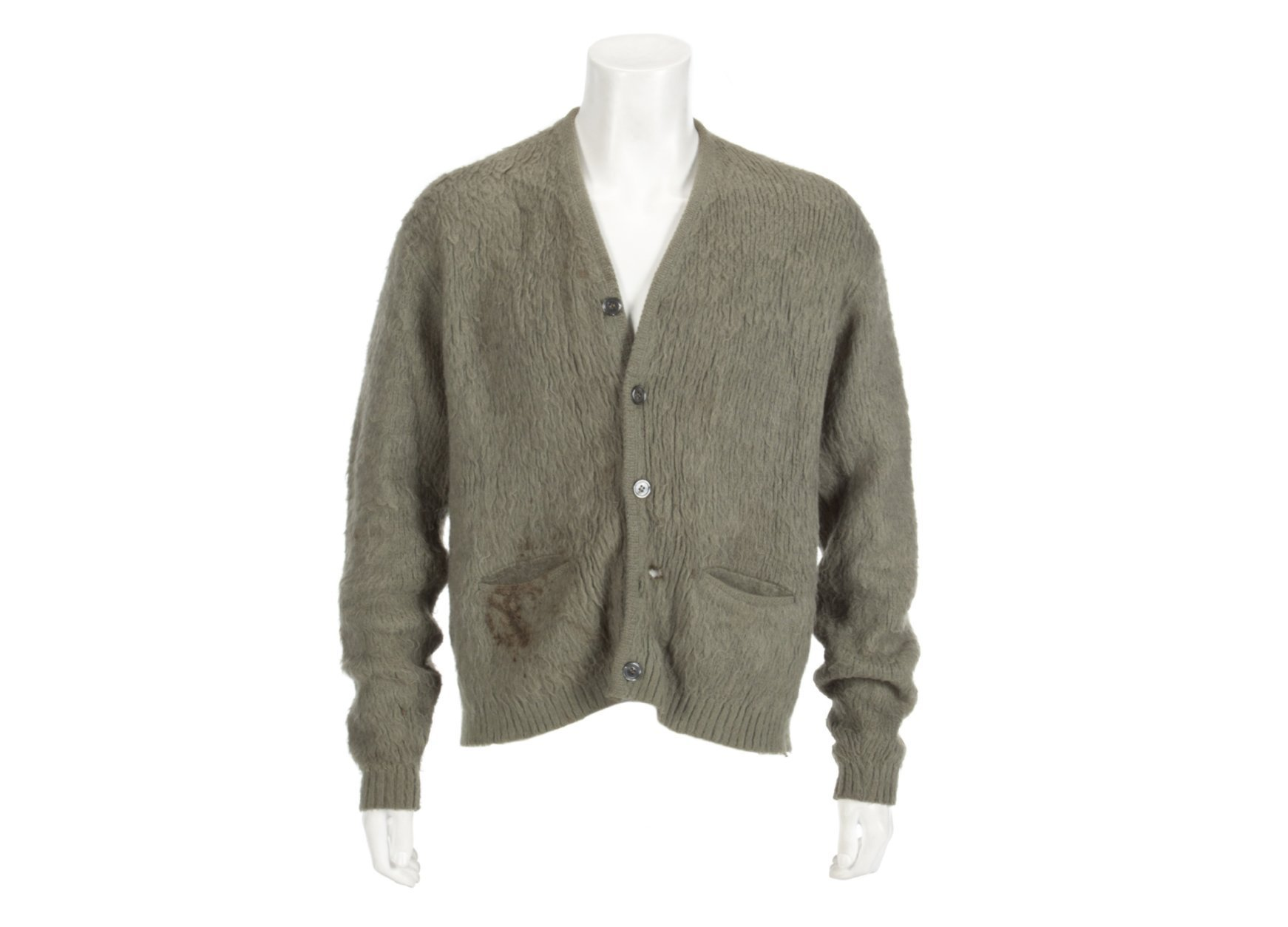 """This image released by Julien's Auctions shows an olive green cardigan sweater worn by Nirvana frontman Kurt Cobain during Nirvana's MTV's """"Unplugged"""" performance. The sweater, along with Cobain's custom Fender guitar, are among many rock and roll items up for auction on Oct. 25 and 26. (Julien's Auctions via AP)"""