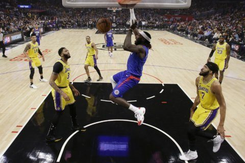 Leonard, Clippers pull away from Lakers in season opener