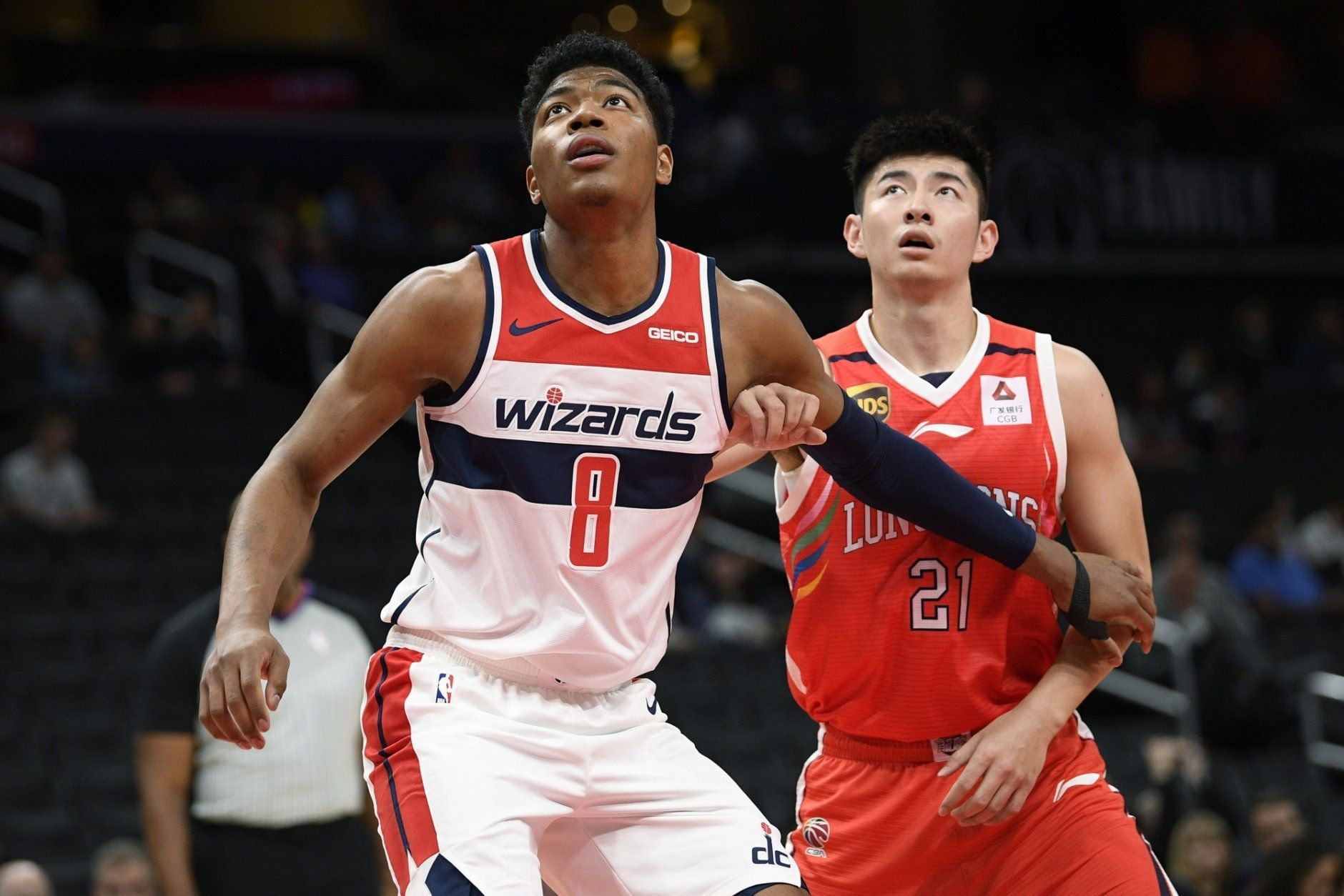 Washington Wizards forward Rui Hachimura (8) and Guangzhou Loong-Lions forward Yifeng Heng (21) wait fora rebound during the first half of an NBA exhibition basketball game Wednesday, Oct. 9, 2019, in Washington. (AP Photo/Nick Wass)