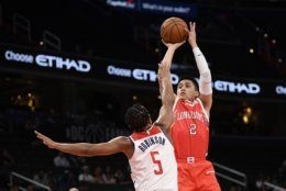 Guangzhou Loong-Lions guard Ying-Chun Chen (2) shoots over Washington Wizards guard Justin Robinson (5) during the first half of an NBA exhibition basketball game Wednesday, Oct. 9, 2019, in Washington. (AP Photo/Nick Wass)
