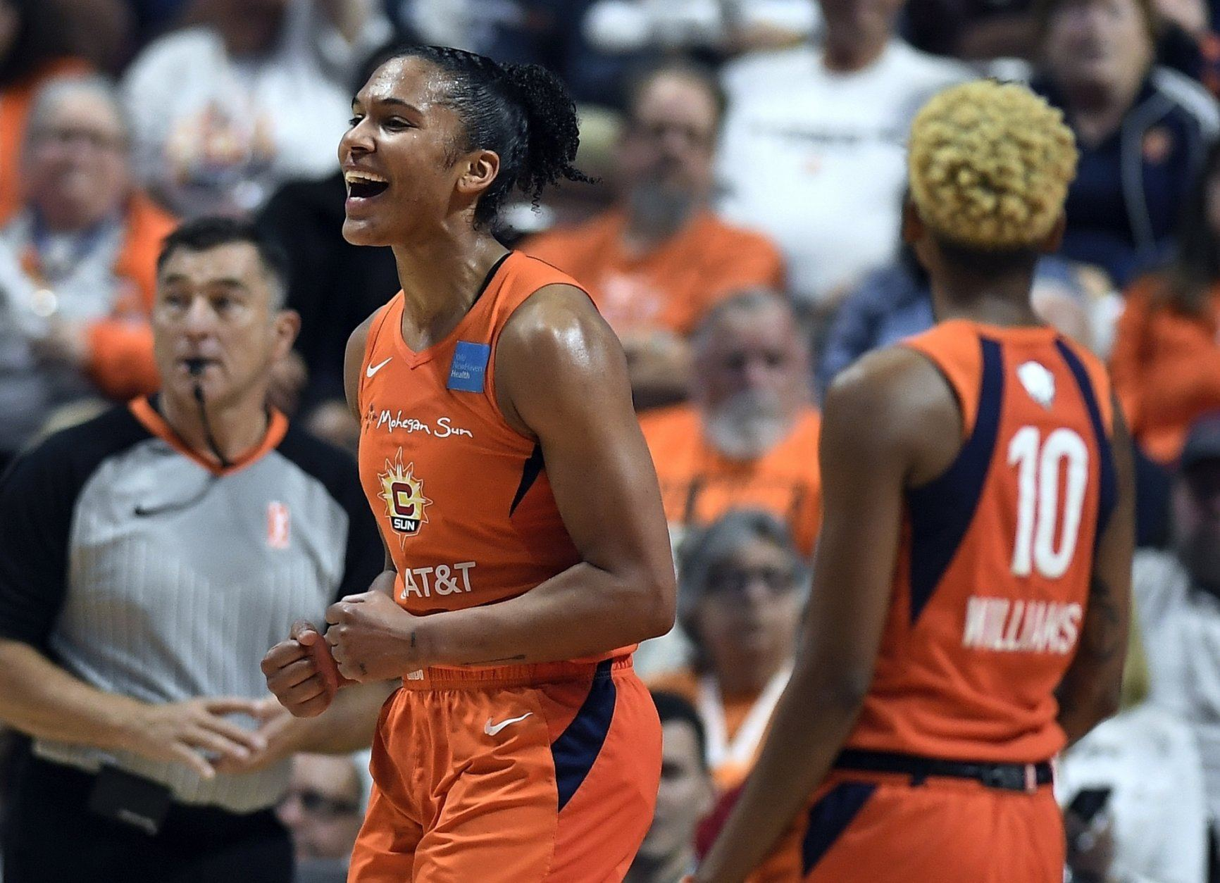 Connecticut Sun's Alyssa Thomas reacts to a play during the first half in Game 4 of basketball's WNBA Finals against the Washington Mystics, Tuesday, Oct. 8, 2019, in Uncasville, Conn. (AP Photo/Jessica Hill)