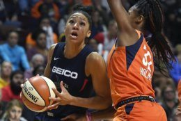 Washington Mystics' Aerial Powers, left, drives to the basket as Connecticut Sun's Bria Holmes defends during the second half in Game 4 of basketball's WNBA Finals, Tuesday, Oct. 8, 2019, in Uncasville, Conn. (AP Photo/Jessica Hill)