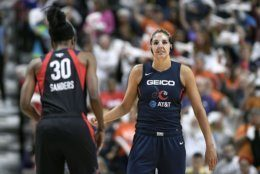 Washington Mystics' Elena Delle Donne, right, and LaToya Sanders, left, stand on the court during the first half in Game 3 of basketball's WNBA Finals against the Connecticut Sun, Sunday, Oct. 6, 2019, in Uncasville, Conn. (AP Photo/Jessica Hill)
