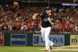 Washington Nationals' Daniel Hudson celebrates after Game 4 of the baseball National League Championship Series Tuesday, Oct. 15, 2019, in Washington. The Nationals won 7-4 to win the series 4-0. (AP Photo/Jeff Roberson)