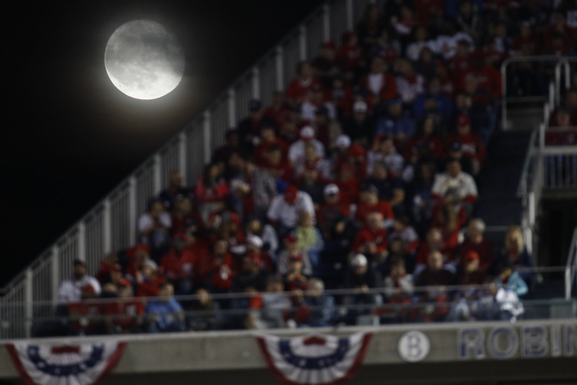 The moon is seen over Nationals Park during the third inning of Game 4 of the baseball National League Championship Series between the St. Louis Cardinals and the Washington Nationals Tuesday, Oct. 15, 2019, in Washington. (AP Photo/Patrick Semansky)