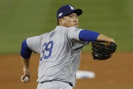 Los Angeles Dodgers starting pitcher Hyun-Jin Ryu throws to a Washington Nationals batter during the second inning in Game 3 of a baseball National League Division Series on Sunday, Oct. 6, 2019, in Washington. (AP Photo/Pablo Martinez Monsivais)