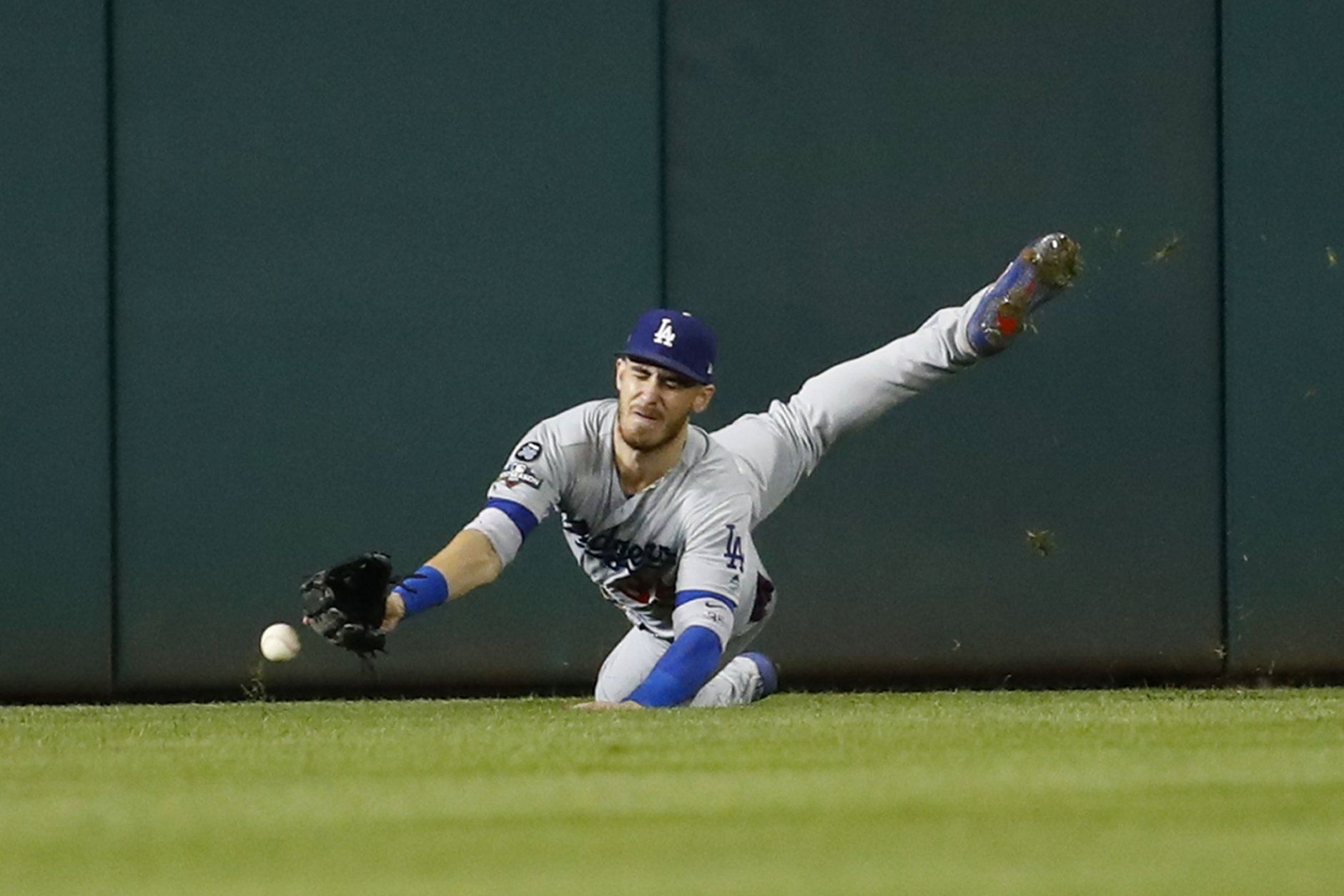 Los Angeles Dodgers center fielder Cody Bellinger (35) misses a ball hit by Washington Nationals shortstop Trea Turner (7) in the sixth inning in Game 4 of a baseball National League Division Series, Monday, Oct. 7, 2019, in Washington. (AP Photo/Alex Brandon)