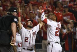Washington Nationals' Juan Soto, right, celebrates with Adam Eaton, left, after hitting a two-run home run off Los Angeles Dodgers starting pitcher Hyun-Jin Ryu during the first inning in Game 3 of a baseball National League Division Series on Sunday, Oct. 6, 2019, in Washington. (AP Photo/Susan Walsh)