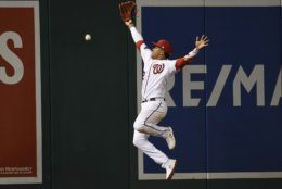 Washington Nationals left fielder Juan Soto misses a double by Los Angeles Dodgers' David Freese during the seventh inning in Game 3 of a baseball National League Division Series on Sunday, Oct. 6, 2019, in Washington. (AP Photo/Susan Walsh)