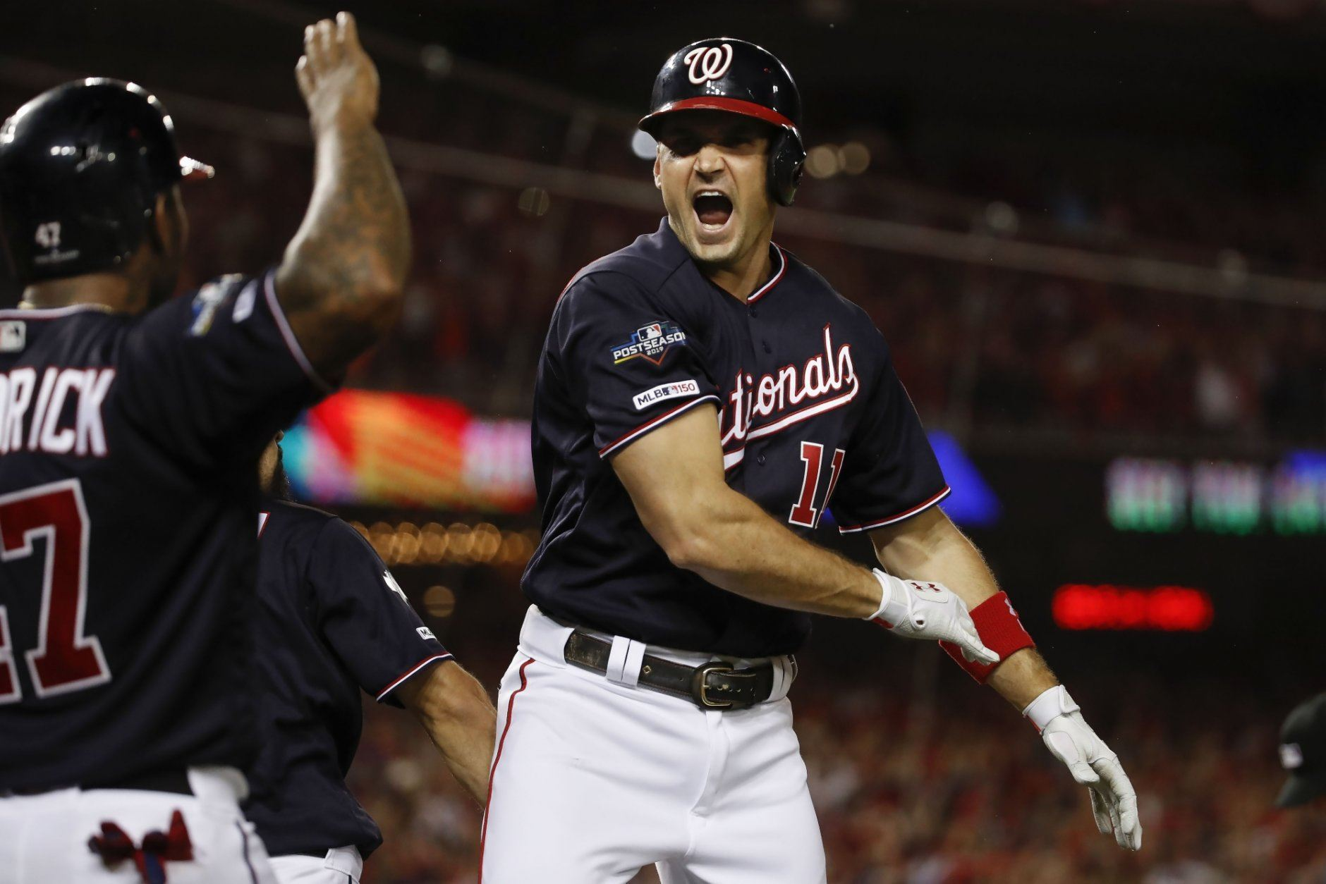 Washington Nationals first baseman Ryan Zimmerman celebrating his three-run homer off Los Angeles Dodgers relief pitcher Pedro Baez (52) with teammate Howie Kendrick in the fifth inning in Game 4 of a baseball National League Division Series, Monday, Oct. 7, 2019, in Washington.(AP Photo/Alex Brandon)