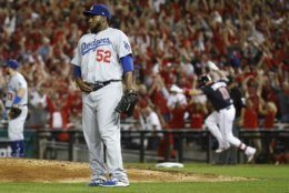 Los Angeles Dodgers relief pitcher Pedro Baez (52) looks away after giving up a three-run homer to Washington Nationals first baseman Ryan Zimmerman (11) during the fifth inning in Game 4 of a baseball National League Division Series on Monday, Oct. 7, 2019, in Washington. (AP Photo/Patrick Semansky)
