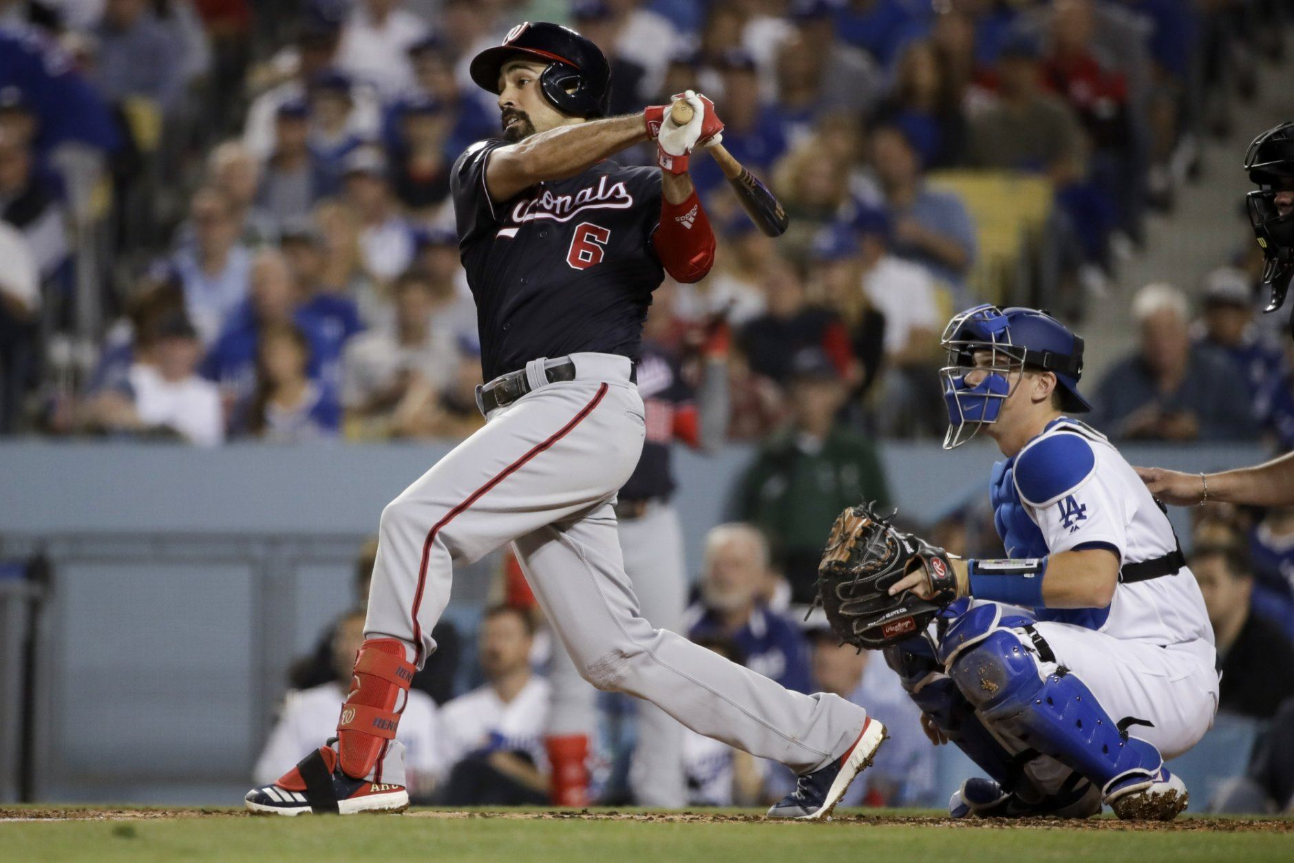 Washington Nationals' Anthony Rendon watches his RBI double against the Los Angeles Dodgers during the second inning in Game 2 of a baseball National League Division Series on Friday, Oct. 4, 2019, in Los Angeles. (AP Photo/Marcio Jose Sanchez)