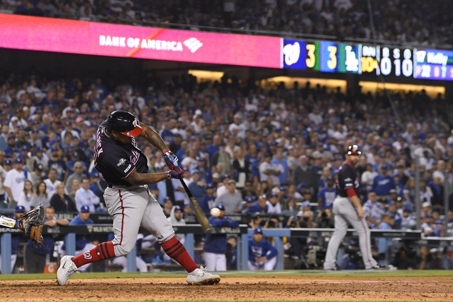 Washington Nationals' Howie Kendrick hits a grand slam against the Los Angeles Dodgers during the 10th inning in Game 5 of a baseball National League Division Series on Wednesday, Oct. 9, 2019, in Los Angeles. (AP Photo/Mark J. Terrill)