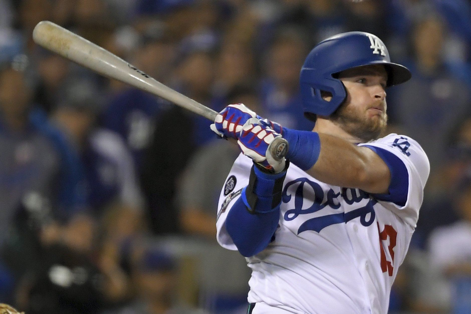 Los Angeles Dodgers' Max Muncy watches his two-run single against the Washington Nationals during the seventh inning of Game 1 in baseball's National League Divisional Series on Thursday, Oct. 3, 2019, in Los Angeles. (AP Photo/Mark J. Terrill)