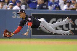 Washington Nationals left fielder Juan Soto catches a fly ball hit by Los Angeles Dodgers' Clayton Kershaw during the third inning in Game 2 of a baseball National League Division Series on Friday, Oct. 4, 2019, in Los Angeles. (AP Photo/Mark J. Terrill)