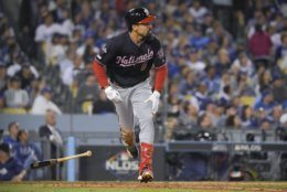 Washington Nationals' Anthony Rendon watches his home run against the Los Angeles Dodgers during the eighth inning in Game 5 of a baseball National League Division Series on Wednesday, Oct. 9, 2019, in Los Angeles. (AP Photo/Mark J. Terrill)