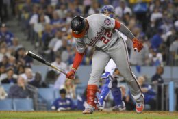 Washington Nationals' Juan Soto slams his bat after striking out against the Los Angeles Dodgers during the seventh inning of Game 1 in baseball's National League Divisional Series on Thursday, Oct. 3, 2019, in Los Angeles. (AP Photo/Mark J. Terrill)