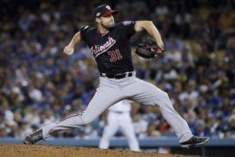 Washington Nationals pitcher Max Scherzer throws to a Los Angeles Dodgers batter during the eighth inning in Game 2 of a baseball National League Division Series on Friday, Oct. 4, 2019, in Los Angeles. (AP Photo/Marcio Jose Sanchez)