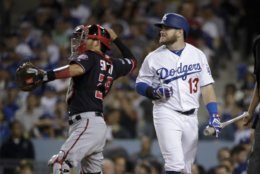 Los Angeles Dodgers' Max Muncy reacts after striking out against the Washington Nationals during the fifth inning in Game 2 of a baseball National League Division Series on Friday, Oct. 4, 2019, in Los Angeles. (AP Photo/Marcio Jose Sanchez)