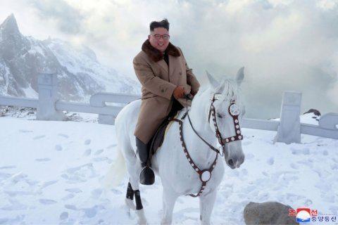 Kim vows to fight US sanctions, visits sacred N. Korean peak