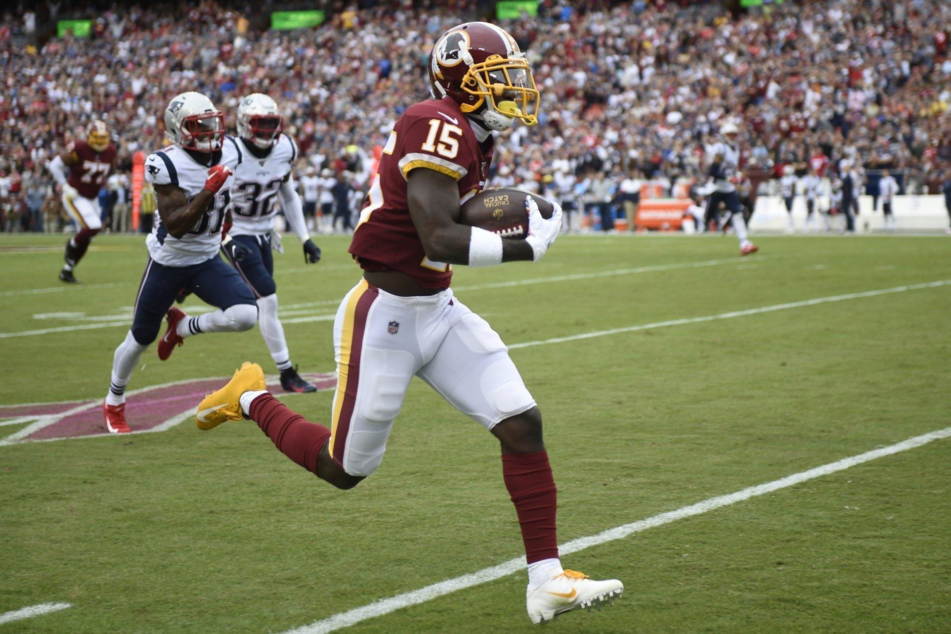 Washington Redskins wide receiver Steven Sims (15) runs for 65-yards for a touchdown against the New England Patriots during the first half of an NFL football game, Sunday, Oct. 6, 2019, in Washington. (AP Photo/Nick Wass)