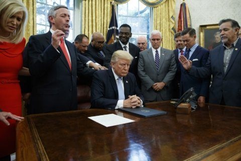 Religious right sticks by Trump as political heat rises