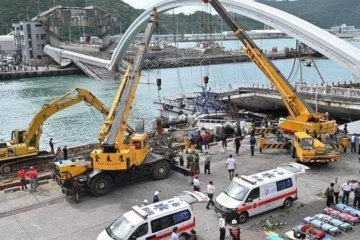 Taiwan bridge collapses, sending truck plunging onto fishing boats