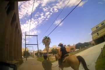Mounted officer said 'this is gonna look really bad' before leading an arrested man down the street in Galveston