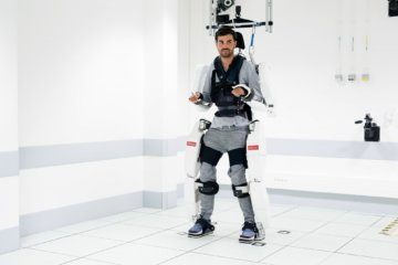 Paralyzed man walks using brain-controlled robotic suit