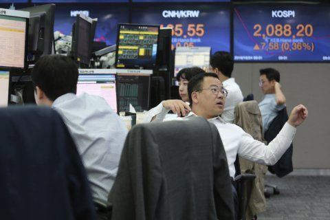 Asian shares mixed as earnings drive modest Wall St gains