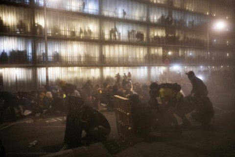 AP PHOTOS: Riot police clash with protesters in Barcelona