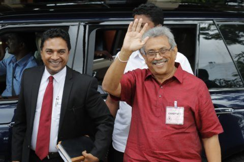 Sri Lankan leader's party to support Rajapaksa in polls