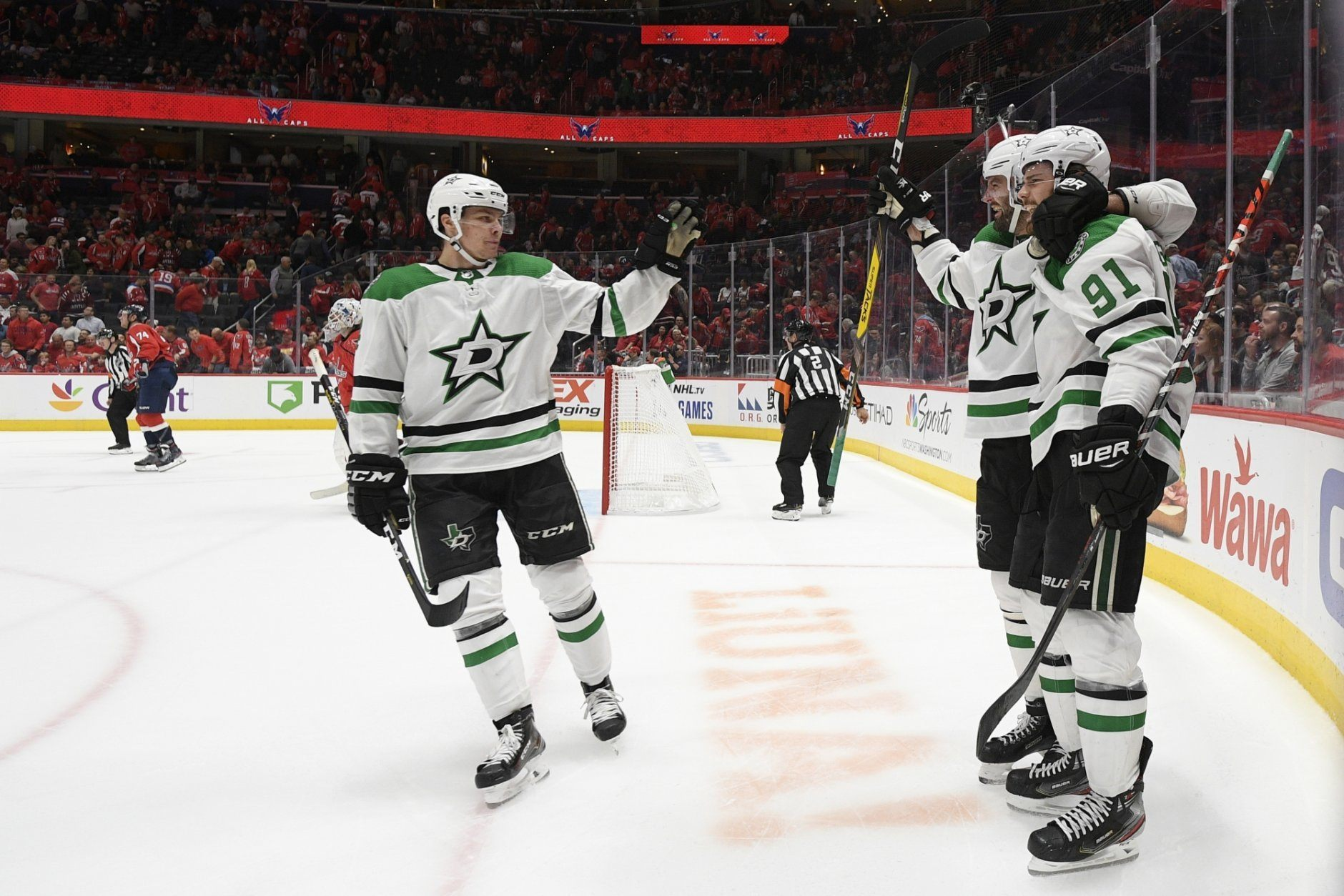 Dallas Stars center Tyler Seguin (91) celebrates his goal with Alexander Radulov, center, of Russia, and Miro Heiskanen, left, of Finland, in overtime of the team's NHL hockey game against the Washington Capitals, Tuesday, Oct. 8, 2019, in Washington. The Stars won 4-3. (AP Photo/Nick Wass)