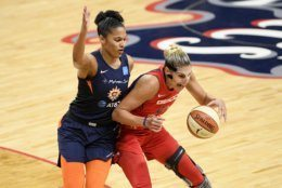 Washington Mystics forward Elena Delle Donne, right, dribbles the ball next to Connecticut Sun forward Alyssa Thomas, left, during the first half of Game 5 of basketball's WNBA Finals, Thursday, Oct. 10, 2019, in Washington. (AP Photo/Nick Wass)