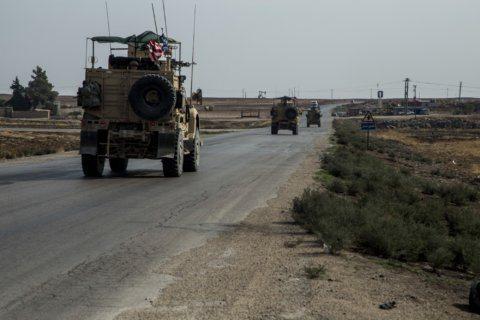 The Latest: House OKs bill punishing Turkey for Syria move