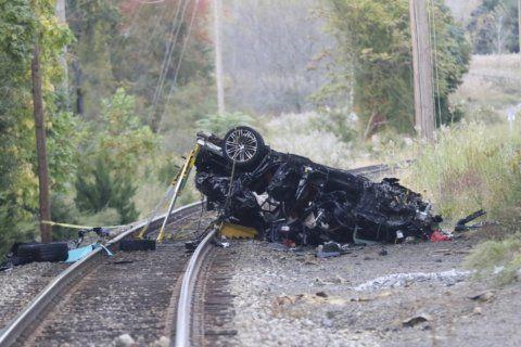 Porsche SUV plunges onto train tracks, burns; 2 teens die