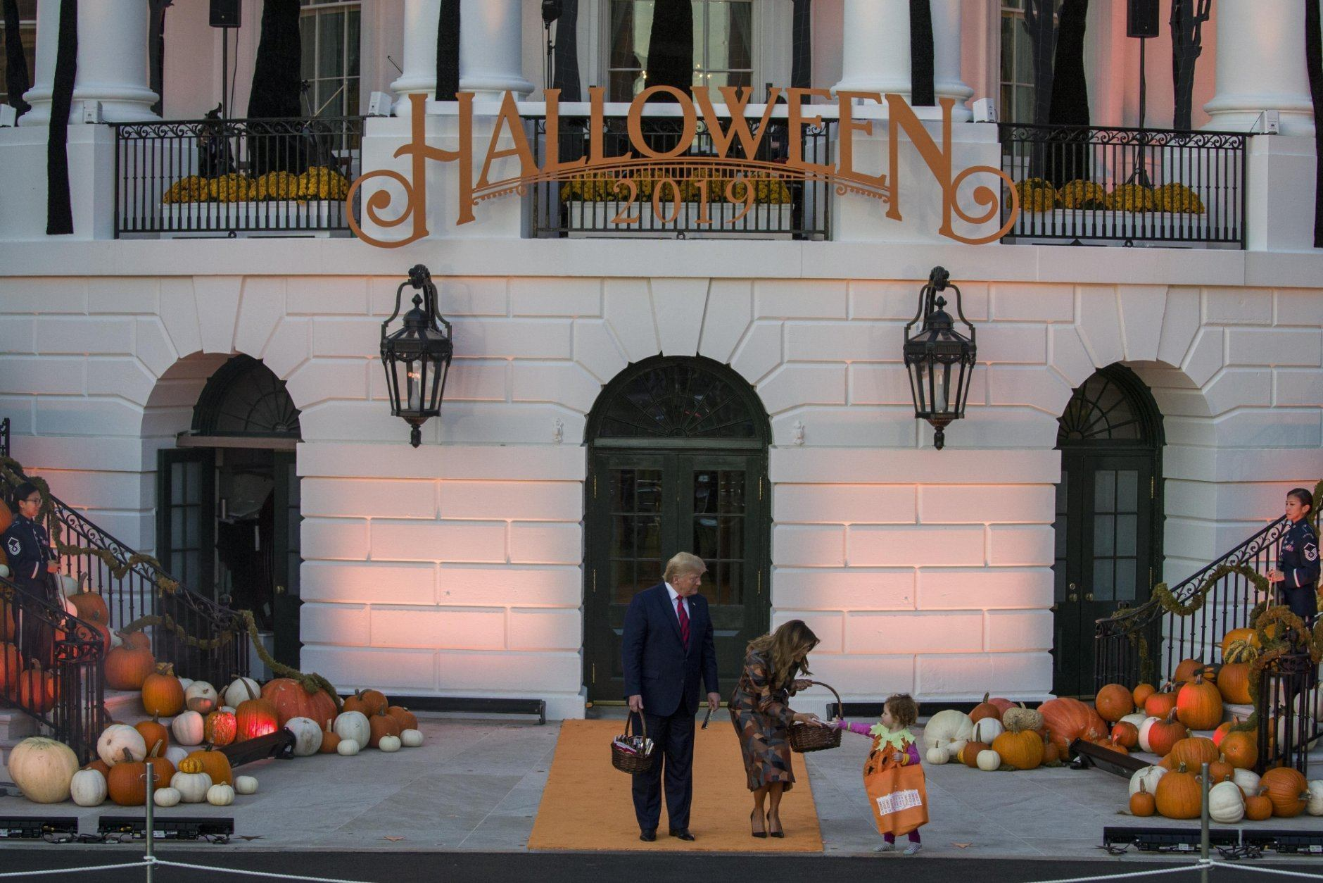 Trumps hand out Halloween candy, greet kids at White House