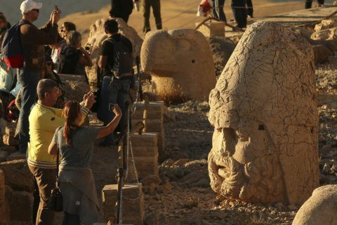 AP PHOTOS: Sunset on Turkey's massive stone heads