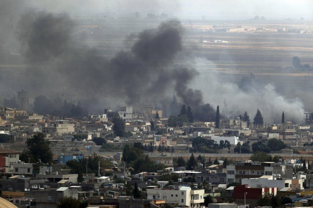 Smoke billows from targets in Ras al-Ayn, Syria, during bombardment by Turkish forces, Wednesday