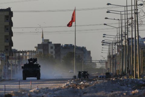The Latest: Turkey says troops captured Syrian border town