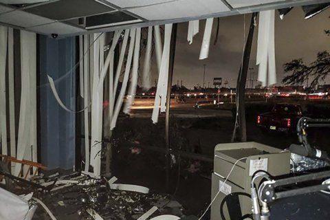 The Latest: Bushes home spared by Dallas tornado