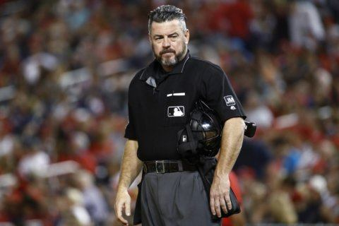 Ump apologizes for tweet referencing gun and Trump critics