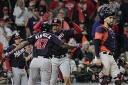 Washington Nationals' Howie Kendrick is congratulated by Juan Soto after hitting a two-run home run during the seventh inning of Game 7 of the baseball World Series against the Houston Astros Wednesday, Oct. 30, 2019, in Houston. (AP Photo/David J. Phillip)