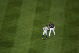 Houston Astros' Jose Altuve talks to Washington Nationals' Juan Soto before Game 3 of the baseball World Series between the Houston Astros and the Washington Nationals Friday, Oct. 25, 2019, in Washington. (AP Photo/Will Newton, Pool)