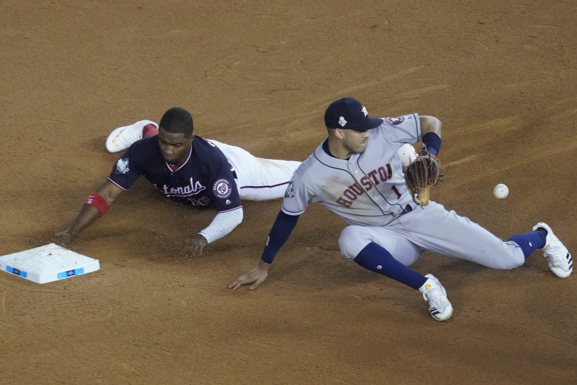 Washington Nationals' Victor Robles steals second with Houston Astros' Carlos Correa covering during the sixth inning of Game 3 of the baseball World Series Friday, Oct. 25, 2019, in Washington. (AP Photo/Pablo Martinez Monsivais)